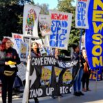 """BCAction at a rally holding signs that read """"Governor Newsom Stand Up to Big Oil."""""""